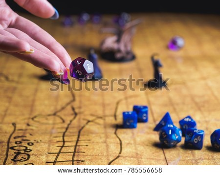 Game field of roleplaying party with dices and miniatures. #785556658