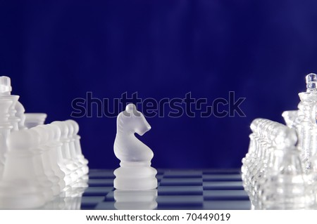 Game for leisure chess with figures on blue background
