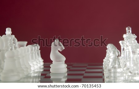 Game for leisure chess with figures on red background