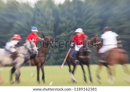 Game in a horse polo. Summer season. Motion blur Zdjęcia stock ©