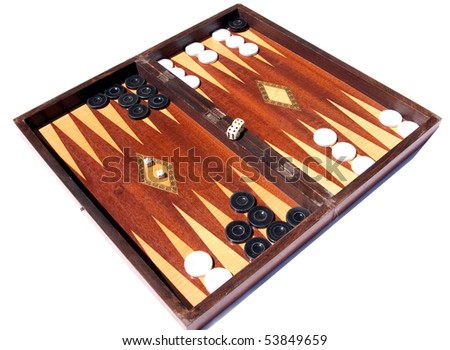 game of backgammon in progress on a well used wooden board