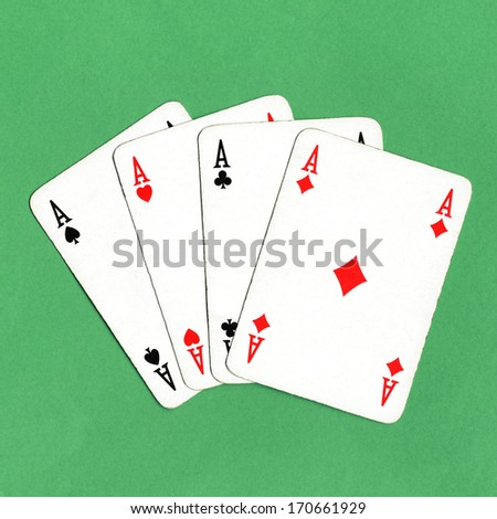 Game of cards with poker of aces over a green game table