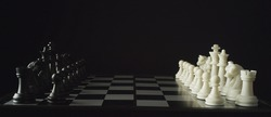 Game of chess. Black pieces on the left, white pieces on the right. Waiting for the start. The concept of business strategy, startup, success. Depth of field