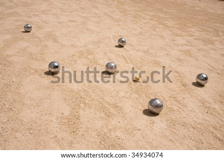 Game of jeu de boule, silver metal  balls in sand. A french ball game