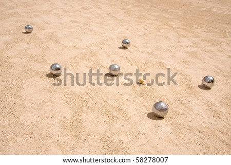 Game of jeu de boule, silvermetal  balls in sand. A french ball game