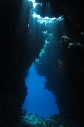 Game of lights inside the cave at Red Sea - underwater landscape