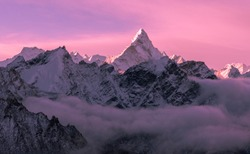 Game of tender pink halftones at sunrise; majestic Ama Dablam peak (6856 m) in Nepal, Himalayas mountains. Greatness of nature concept