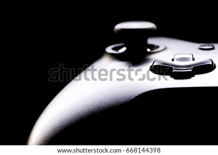 Game-pad on black background - close up studio shot