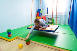 game with cubes girl on Platform suspended projectile for classes on method of sensory integration, correctional and developmental technologies. games and educational activities. therapeutic exercise.