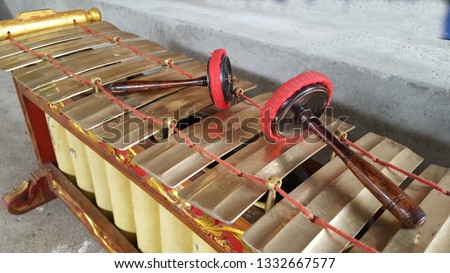 Gamelan, a traditional musical instrument from Java. This type of musical instrument is usually used for staging puppet art or other. Gamelan is one musical instrument without emotional elements #1332667577