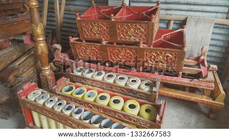 Gamelan, a traditional musical instrument from Java. This type of musical instrument is usually used for staging puppet art or other. Gamelan is one musical instrument without emotional elements #1332667583