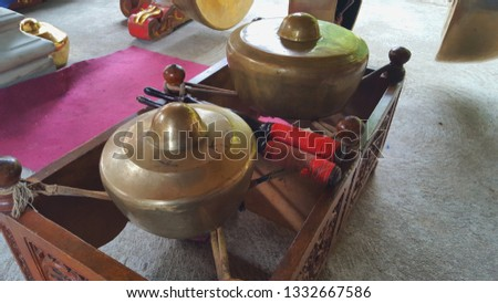 Gamelan, a traditional musical instrument from Java. This type of musical instrument is usually used for staging puppet art or other. Gamelan is one musical instrument without emotional elements #1332667586
