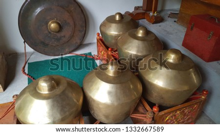 Gamelan, a traditional musical instrument from Java. This type of musical instrument is usually used for staging puppet art or other. Gamelan is one musical instrument without emotional elements #1332667589