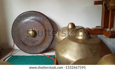 Gamelan, a traditional musical instrument from Java. This type of musical instrument is usually used for staging puppet art or other. Gamelan is one musical instrument without emotional elements #1332667595