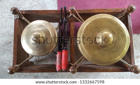 Gamelan, a traditional musical instrument from Java. This type of musical instrument is usually used for staging puppet art or other. Gamelan is one musical instrument without emotional elements #1332667598