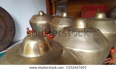 Gamelan, a traditional musical instrument from Java. This type of musical instrument is usually used for staging puppet art or other. Gamelan is one musical instrument without emotional elements #1332667601
