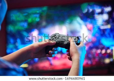 Gamer holding Gamepad, Controller or Videogame Joystick Console in hands. Close up, game concept
