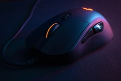 Gamer mouse, with contrasting lighting and colors that refer to technology