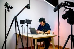 Gamer, streamer, or Youtuber streaming and recording in his home studio