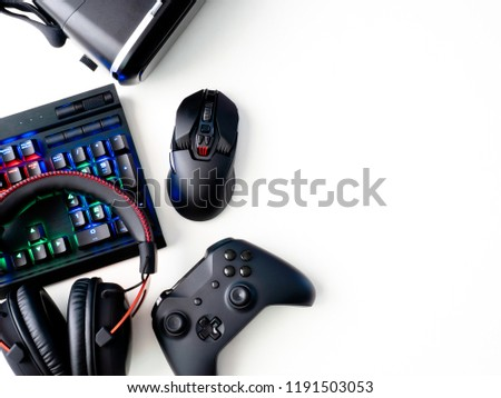 gamer workspace concept, top view a gaming gear, mouse, keyboard, joystick, headset and mouse pad on white table background with copyspace. #1191503053