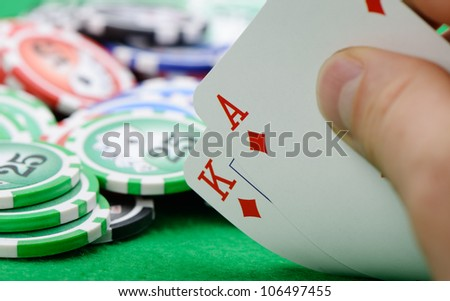 Gaming cards  in hand on the green cloth. A winning combination in Black Jack