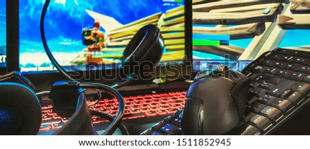 Gaming computer, laptop, keyboard, headphones and mouse headset for video gamer games on a dark background with copy space, concept of the latest gaming game technology long banner #1511852945