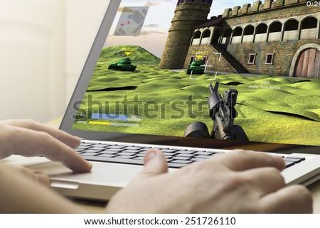 gaming concept: man using a laptop to play war game