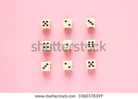 Gaming dice organized in rows on pink background in flat style. Concept for banners, web, games, web, presentation. Top view. #1060378349
