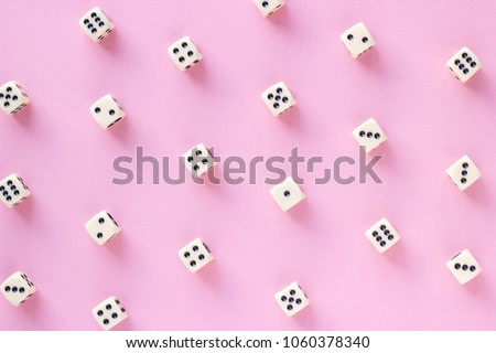 Gaming dice pattern on pink background in flat lay style. Concept for games, game board, presentation, banners or web. Top view. Close-up. #1060378340