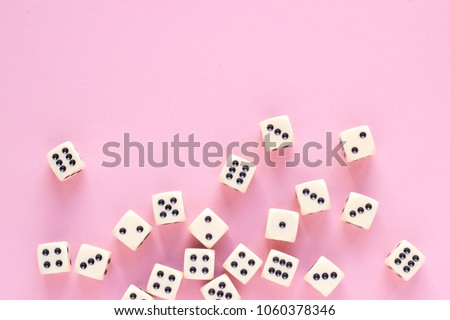 Gaming dice with copy space on pink background. Concept for games, game board, presentation, banners or web. Top view. Close-up. #1060378346