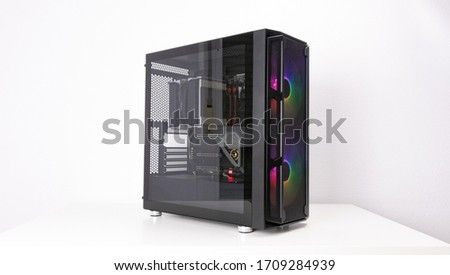 Gaming PC with RGB LED lights and big fans on the front. Computer assembled with hardware components Foto stock ©
