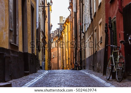 stock photo gamla stan stockholm sweden colorful cobbled street in old town color street with cobblestone 502463974 - Каталог — Фотообои «Улицы, переулки»