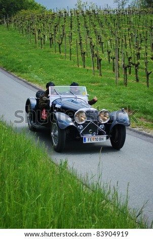 "GAMLITZ, AUSTRIA - APRIL 30: An unidentified driver in a 1936 Jaguar SS100 participates in a rally for vintage cars ""Suedsteiermark Classic"" on April 30, 2011 in Gamlitz, Austria."