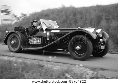 """GAMLITZ, AUSTRIA - APRIL 30: An unidentified driver in a 1937 Jaguar SS 100 participates in a rally for vintage cars """"Suedsteiermark Classic"""" on April 30, 2011 in Gamlitz, Austria."""