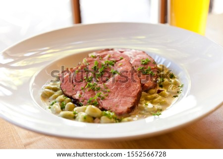 Gammon, smoked pork, with broad beans
