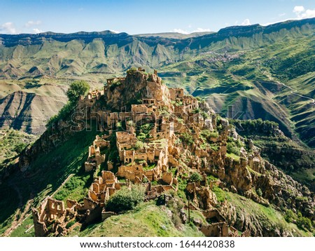 Gamsutl village in Caucasus Mountains. Old stone buildings on top of rock. Summer morning landscape in Dagestan, Russia