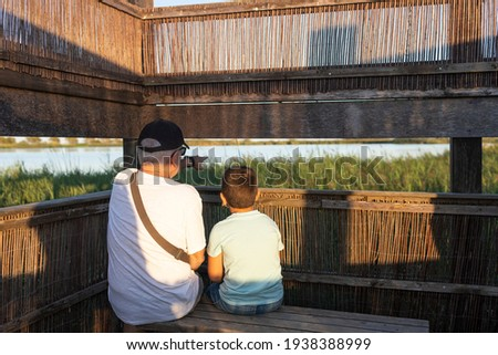 Gandfather and grandson on a bird-watching place Stock photo ©