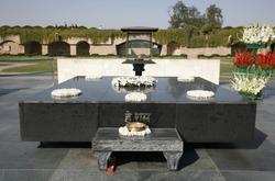 gandhi's memorial tomb stone in rajghat, delhi, india