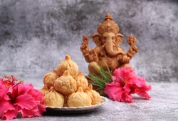 Ganesh Puja - Sweet Modak food offered on Ganpati festival or Chaturthi in India. in silver plate