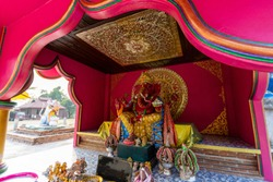 Ganesha and Rat statue in Buddhist temple where is public domain opened for tourists who believe in Hindu god to worship