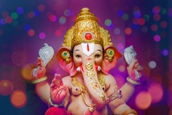Ganesha Festival, Lord Ganesha statue on colorful background
