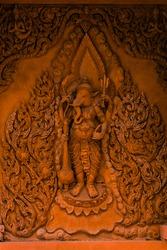 Ganesha on the walls of a Buddhist temple on Koh Samui. Wat Ratchathammaram, one of the iconic temples of Koh Samui. Red temple