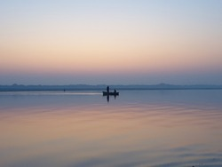 Ganges river sunset with one boat. it is beuatiful