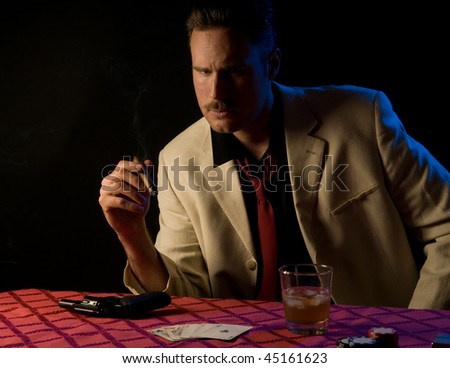 Gangster/gambler with gun during poker game - he has a full house