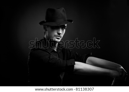 Gangster look. Handsome man with hat.