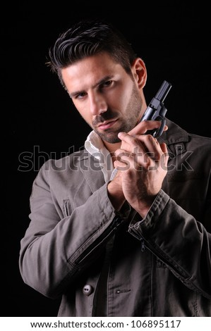 Gangster or private security or detective with a gun