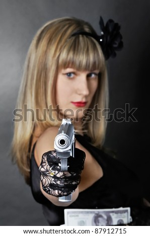 Gangster woman with pistol (focus on pistol)