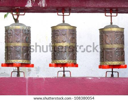GANGTOK, SIKKIM/ INDIA-JUNE 12: Row of Brown Prayer Wheels at Enchey Monastery for Buddhist turning and praying on June 12, 2012 in Gangtok. Enchey Monastery is among Sikkim's famous monuments.