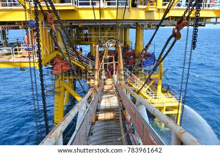 Gangway access from installation barge to platform during platform construction #783961642