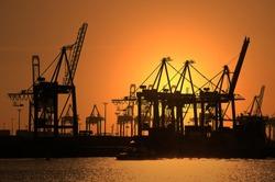 Gantry cranes, harbour cranes, container terminal, sunset, port, Hamburg, Germany